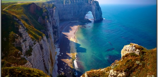 The famous Etretat cliffs in Normandy. Photo via Flickr:Moyan Brenn