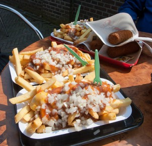 "Dutch fries with curry ketchup, onions and ""kroketten"""