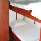 The two cabins below deck have two beds arranged one above the other.