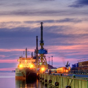 Rostock Harbor at sunset - photo via Wikimedia Commons:Maurice